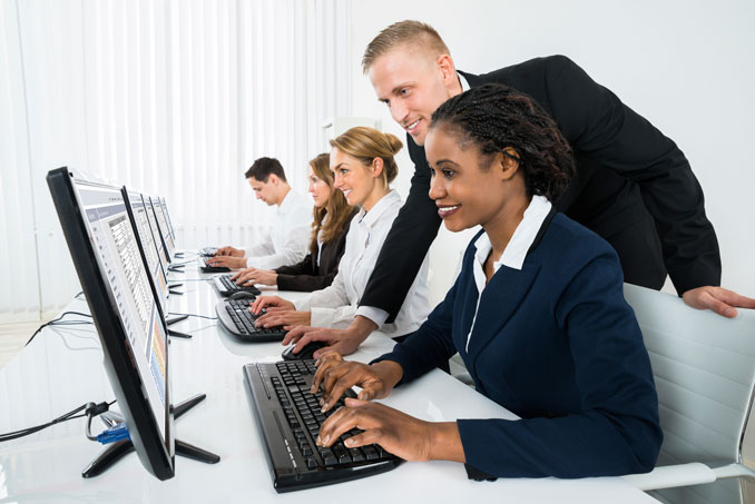 Computer Instructor assisting students